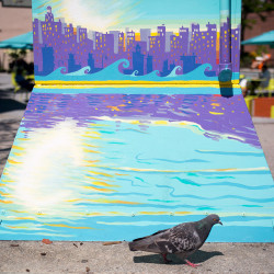 A utility box in Congress Square Park by Kerrin Parkinson depicts a cityscape on water.