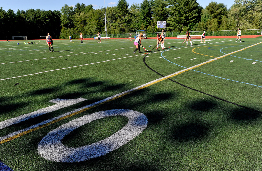 The Yarmouth High School field hockey team practices on its turf field on Friday.