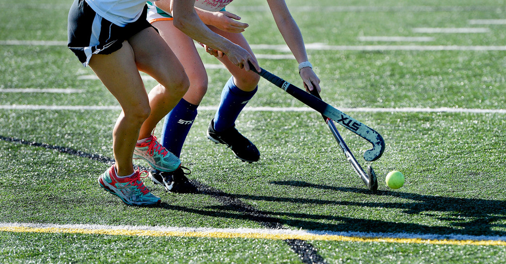 Field hockey players and coaches run drills on the crumb rubber turf field in Yarmouth. While early studies in crumb rubber showed that the tiny pellets contained traces of toxic elements, none were found to be at levels dangerous to a person's health.