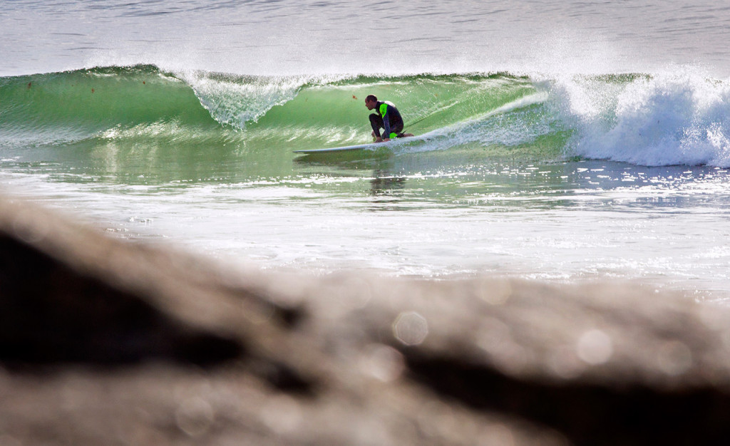 A surfer is shown at Fortunes Rocks Beach in Biddeford in 2016. Multiple people were rescued there after getting caught in rip currents on Wednesday.