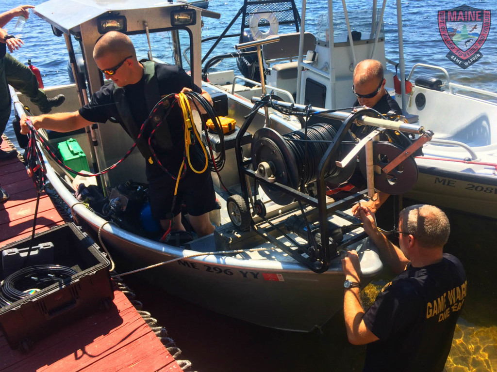 Side scan sonar is fitted to the front of a Maine Warden Service boat Thursday in the search for the teenager from Hollis who fell off a boat in Long Lake on Wednesday.