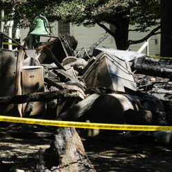Six buildings at the site of the Washington Advent Christian Camp, including a two-story dormitory, were destroyed in a fire Monday. More than 50 buildings are part of the property and the camp association plans to rebuild.