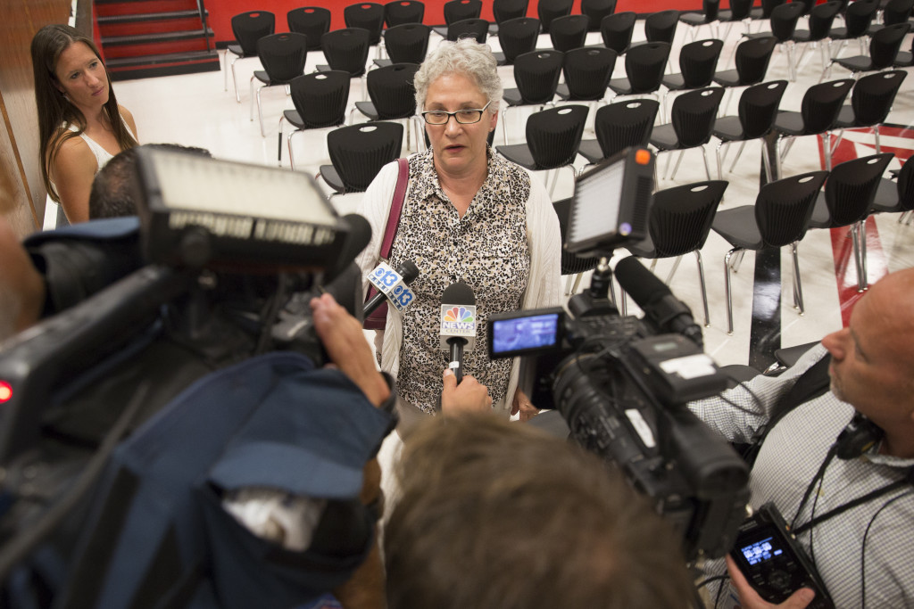 State Rep. Patricia Hymanson (D-York) meets with reporters after a heated exchange with Gov. Paul LePage. (Photo by Ben McCanna/Staff Photographer)