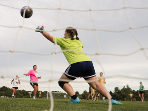 Sophomore Savannah Lemieux tries to make a save during the season's first practice on MOnday. Carl D. Walsh/Staff Photographer