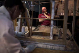 Husband and wife team Greg and Leah Gordon, shown in their workshop at their home in Hope, have been restoring windows of historical homes and buildings for the past 10 years.