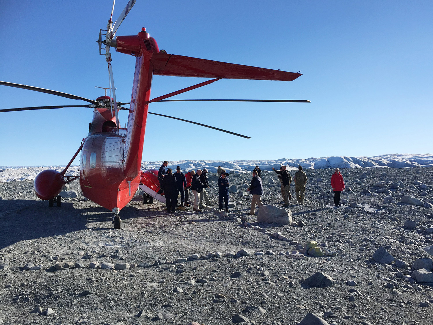 Sen. Angus King, Coast Guard Commandant Paul F. Zukunft and Danish defense and meteorological officials work Monday during a three day fact-finding mission to Greenland, examining the environmental and security implications of the warming Arctic climate.