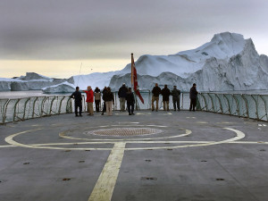 U.S. and Danish defense and meteorological delegations survey an iceberg array off the western coast of Greenland. Maine's U.S. Sen. Angus King took part in the three-day fact-finding mission.