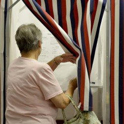 Please write cutline here that pertains to the topic of the editorial.  NEW SHARON - MAINE  JULY 28, 2016 Mary Harris, of New Sharon, enters the voting booth to cast a ballot for the RSU 9 school budget at the New Sharon town office on Thursday, July 28, 2016.  (Staff Photo/Michael G. Seamans)