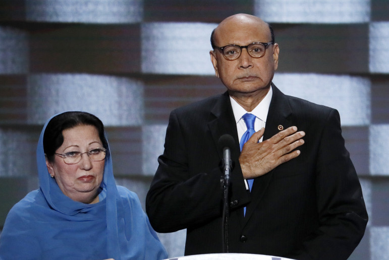 Khizr Khan, father of fallen Army Capt. Humayun S.M. Khan, speaks during the final day of the Democratic National Convention in Philadelphia. Khizr Khan's wife, Ghazala, stands at his side.