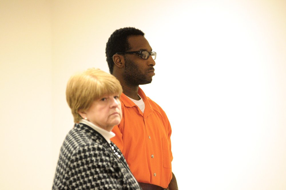 Defense attorney Pamela Ames stands with David W. Marble Jr. during a hearing in December 2015. Marble, who is being held on two counts of murder, pleaded no contest Wednesday to threatening a corrections officer.