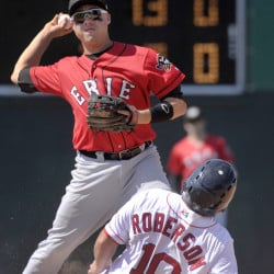 Erie SeaWolves second baseman Corey Jones unsuccessfully tries to turn a double play after forcing out Tim Roberson of the Sea Dogs in the ninth inning Thursday afternoon at Hadlock Field. Erie won, 9-3.