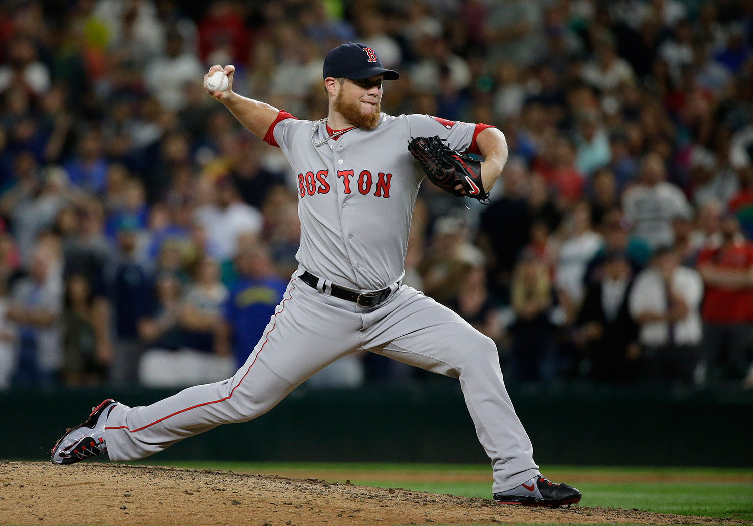 Boston Red Sox pitcher Craig Kimbrel throws against the Seattle Mariners in the 10th inning of Thursday's game in Seattle. Kimbrel picked up the win as the Red Sox beat the Mariners 3-2 in 11 innings.