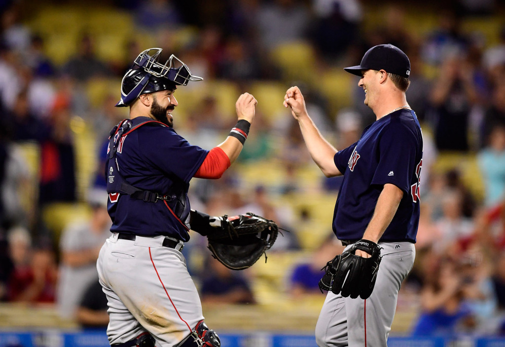 Boston Red Sox catcher Sandy Leon, left, congratulates starting pitcher Steven Wright after the Red Sox defeated the Los Angeles Dodgers 9-0 Friday. Associated Press/Mark J. Terrill