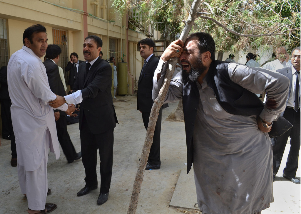 Pakistani lawyers mourn the deaths of their colleagues following a bomb blast. A powerful bomb went off inside a government-run hospital in the southwestern city of Quetta on Monday, killing dozens of people and wounding dozens of others, police said. Associated Press/Arshad Butt