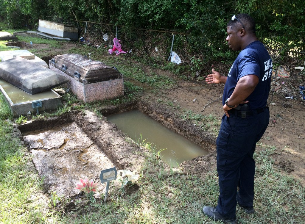 Willie Brooks III stands at the grave of his grandmother, whose body was lost in the floods, on Thursday in Plainview Cemetery in Denham Springs, La.  Associated Press/Joshua Replogle