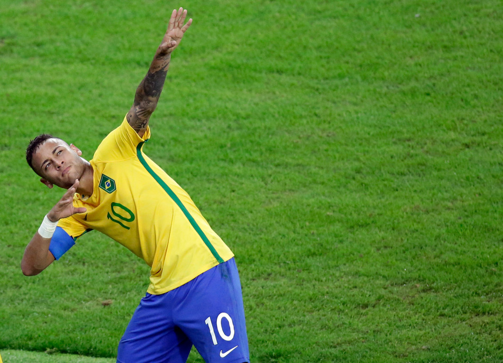 Brazil's Neymar celebrates after scoring his team's first goal on a free kick during the final match of the men's Olympic soccer tournament between Brazil and Germany at the Maracana stadium in Rio de Janeiro, Brazil, on Saturday. Brazil won in overtime on penalty kicks.