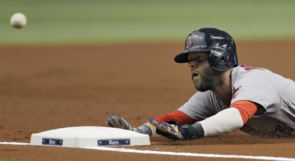 Dustin Pedroia slides into third base ahead of the throw to Tampa Bay's Evan Longoria on Tuesday. Pedroia advanced from second base on a flyout by David Ortiz.    Associated Press/Chris O'Meara