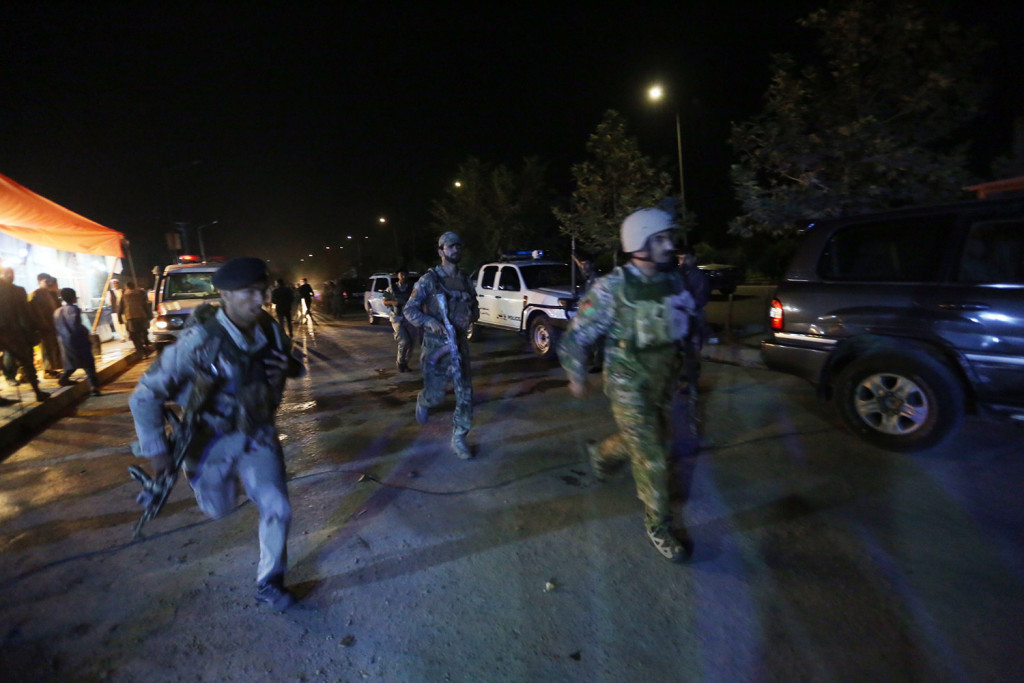 Afghan security forces rush to respond to a complex attack on the campus of the American University in the Afghan capital Kabul on Wednesday.
