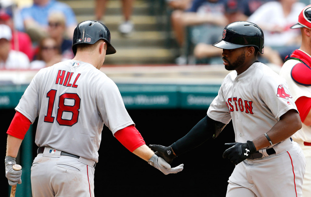 Boston's Jackie Bradley (25) gets congratulations from Aaron Hill (18) after hitting a solo home run off Cleveland Indians starting pitcher Josh Tomlin during the sixth inning.