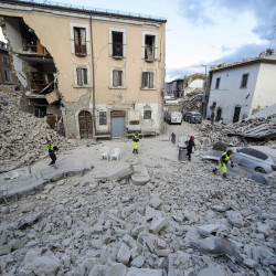 The side of a building collapsed following an earthquake in Amatrice, Italy, Wednesday.  Massimo Percossi/ANSA via AP