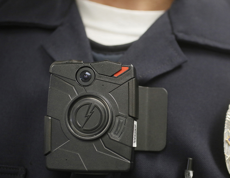 An agreement with Boston's largest police union to have 100 officers wear body cameras is praised as a step toward greater accountability. But with the Sept. 1 rollout date for the pilot program approaching, not a single officer had volunteered to wear one. Damian Dovarganes/Associated Press