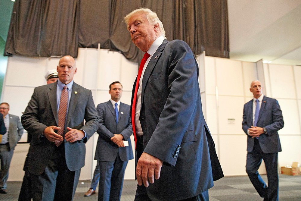 Republican presidential candidate Donald Trump walks away after speaking to reporters before a town hall event Monday in Columbus, Ohio. Evan Vucci/Associated Press