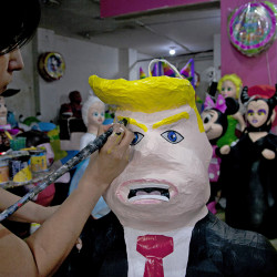 "Alicia Lopez Fernandez paints a pinata depicting Donald Trump at her family's store ""Pinatas Mena Banbolinos"" in Mexico City in this July 10, 2016, photo. Marco Ugarte/Associated Press"