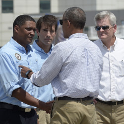 President Barack Obama is greeted by, from left, Rep. Cedric Richmond, D-La., Rep. Garret Graves, R-La., and Sen. Bill Cassidy, R-La., after arriving on Air Force One at Baton Rouge Metropolitan Airport Tuesday. Susan Walsh/Associated Press
