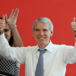 Sen. Rob Portman, R-Ohio, and his wife arrive at the The Rock and Roll Hall of Fame and Museum in Cleveland, in July during the second day of the Republican convention. Portman is betting that a significant number of Ohioans will divide their preferences between the two parties as they work their way down the ballot.