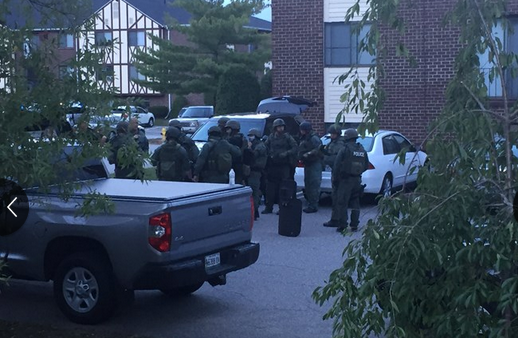"""Police and fire officials respond to a """"hazardous material incident"""" in the Olde English Village complex in South Portland on Sunday night. Courtesy WCSH TV"""