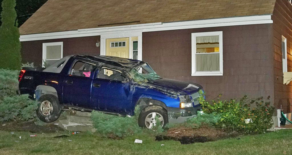Shane McAlister is accused of crashing this SUV into a house in Yarmouth after a police chase on Aug. 26. He then fled. <em>Contributed photo by Tom Bell</em>