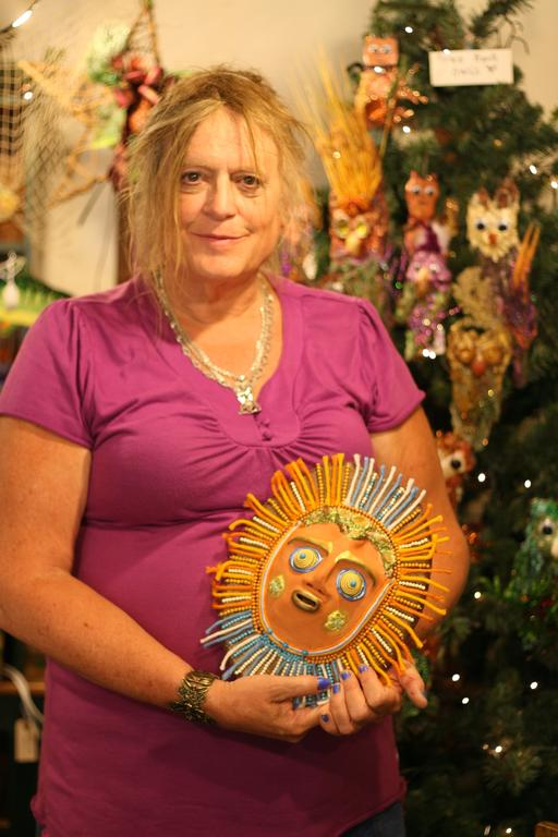 joni fizur of limerick holds an aztec inspired mask in her gallery in steep falls fizur took up painting while working as an aircraft machinist in the us