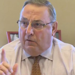 Gov. Paul LePage speaks to reporters about his dispute with Rep. Drew Gattine on Wednesday in Augusta.