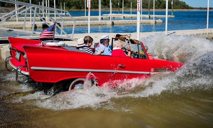 An Amphicar Makes A Splash At The Naples Causeway During Annual Car And Boat Show
