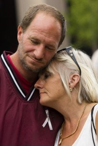 Jeff Wisse of Gorham comforts his girlfriend, Patricia Burnell of South Portland, as they reflect on the loss of three friends in the last six months to drug overdoses. Carl D. Walsh/Staff Photographer