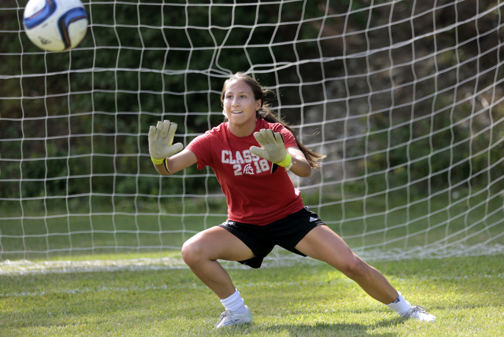 Niki Perez, a junior goalkeeper, keeps her eye on the ball as Sanford High prepares for the girls' soccer season. Sanford, which was once just another team, vaulted to contender status a year ago and graduated just two players.