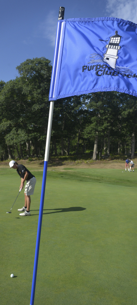 Cole Spencer, a Cape Elizabeth senior, putts on Purpoodock's ninth hole.