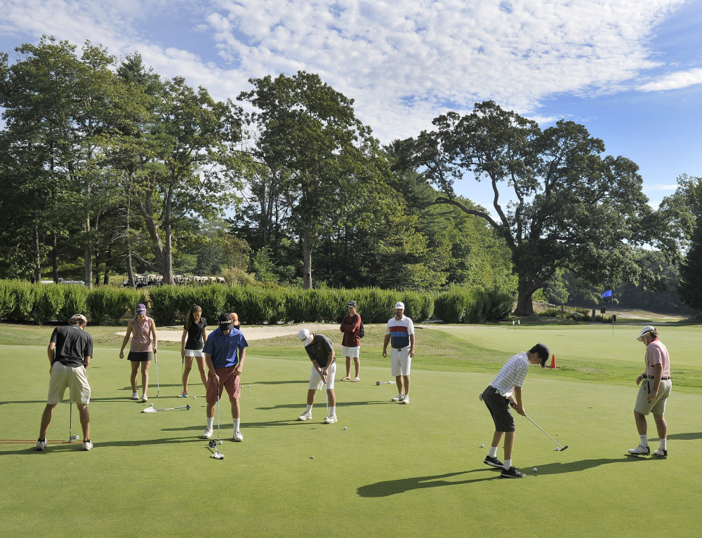 "Members of the Cape Elizabeth golf team work on their putting at Purpoodock Golf Club's practice green one recent morning. Purpoodock tries to give plenty of access to junior players – the club's ""future members."""
