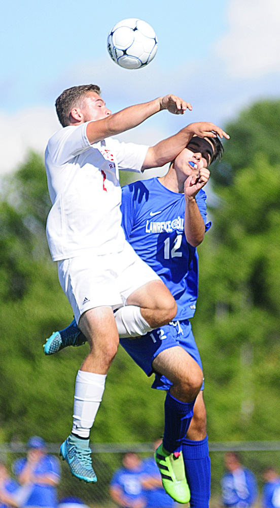 Cony's Jeff Bilodeau, left, and Lawrence's Nathan Buck collide while battling for a header during a game Friday in Augusta.