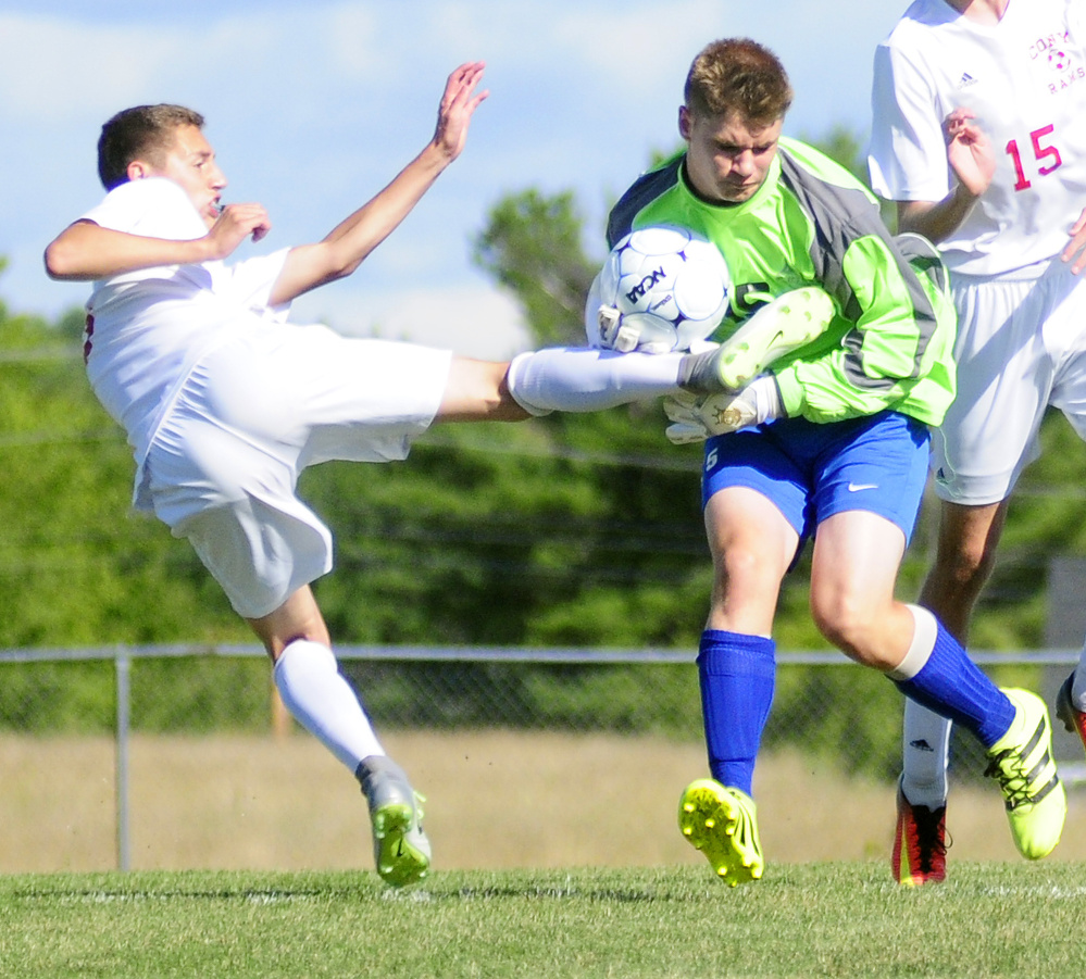 Cony's Bradley Houston, left, tries to follow up on a rebound as Lawrence keeper Alexander Owens tries to hang onto the ball Friday in Augusta.