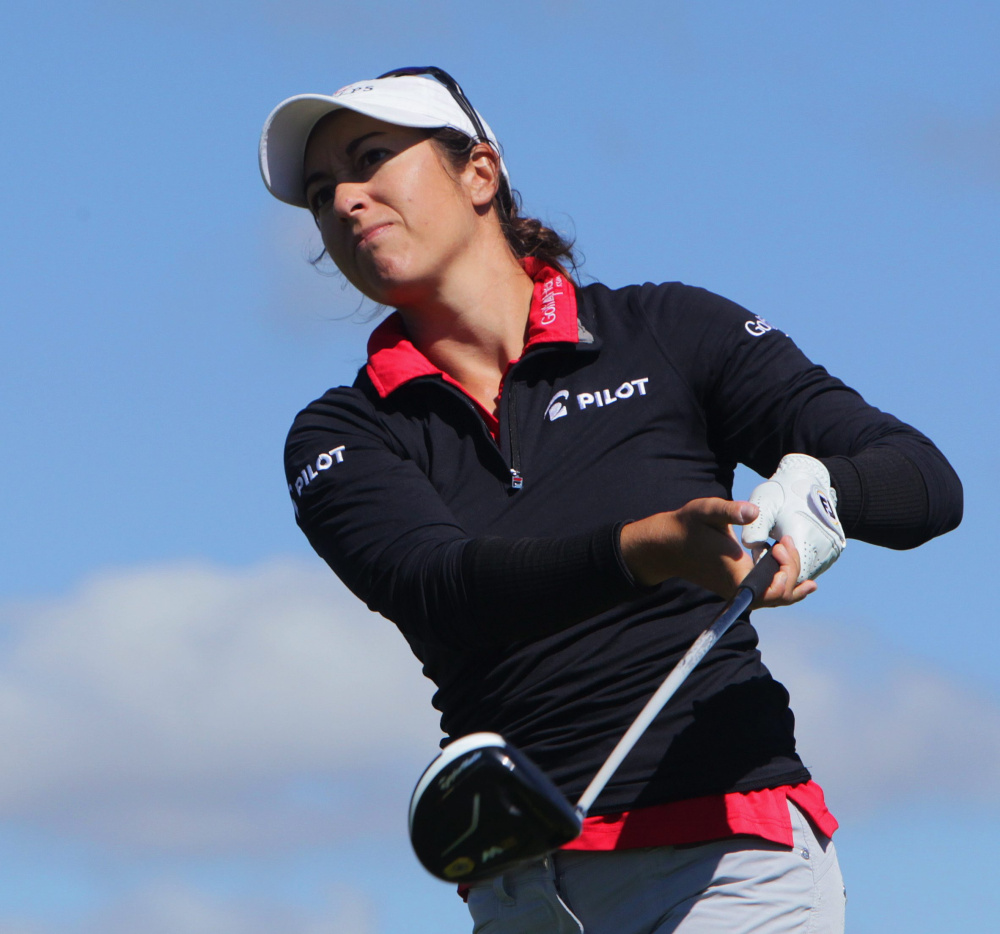 Marina Alex watches her tee shot on the seventh hole at the Manulife Classic golf tournament in Cambridge, Ontario, Friday, Sept. 2, 2016. (Dave Chidley/The Canadian Press via AP)