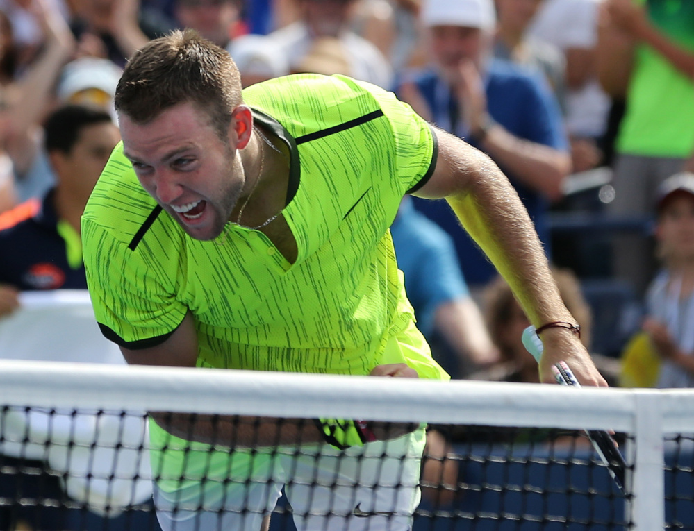 Jack Sock of the United States reacts Friday after defeating Marin Cilic of Croatia in straight sets to reach the fourth round of the U.S. Open for the first time.