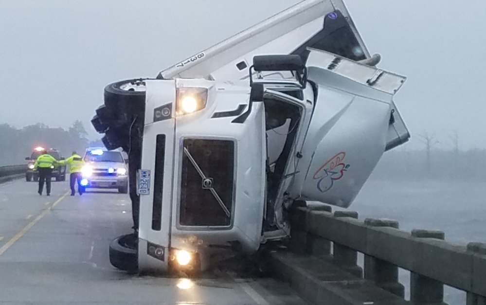 Authorities say high winds from Hermine tipped over an 18-wheeler in Columbia, N.C., on Saturday, killing its driver and shutting down the U.S. 64 bridge.