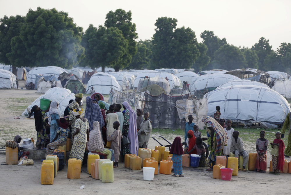 Displaced people in Maiduguri, Nigeria, fetch water. It's feared that polio will be found among ex-captives of Boko Haram.