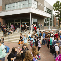 Students gather for the first day of classes last week at Biddeford High School, which is in one of several Maine districts that have made the switch to later morning start times. Teenagers here start the school day at 8:30 a.m., almost a full hour later than last year.