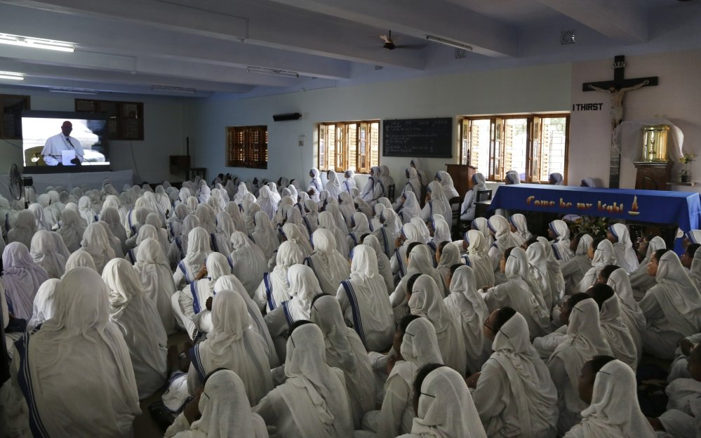 Catholic nuns follow the Canonization Mass of Mother Teresa inside the Mother House, the Missionaries of Charity headquarters,  in Kolkata, India, on Sunday. Associated Press/Bikas Das