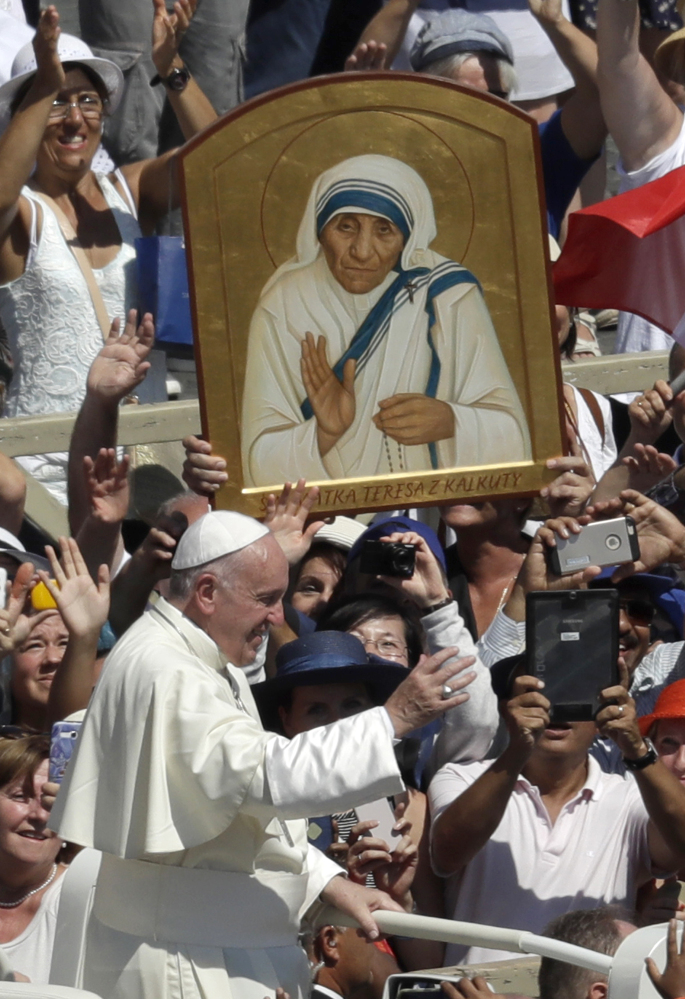 Pope Francis passes in front a portrait of Mother Teresa at the end of a canonization ceremony in St. Peter's Square at the Vatican on Sunday. Associated Press/Alessandra Tarantino