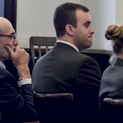Andrew Maderios, center, and his attorneys, Leonard Sharon and Caleigh Milton, listen to the victim's statement at Maderios' sentencing hearing in Somerset County Superior Court. His appeal will be heard Sept. 14.