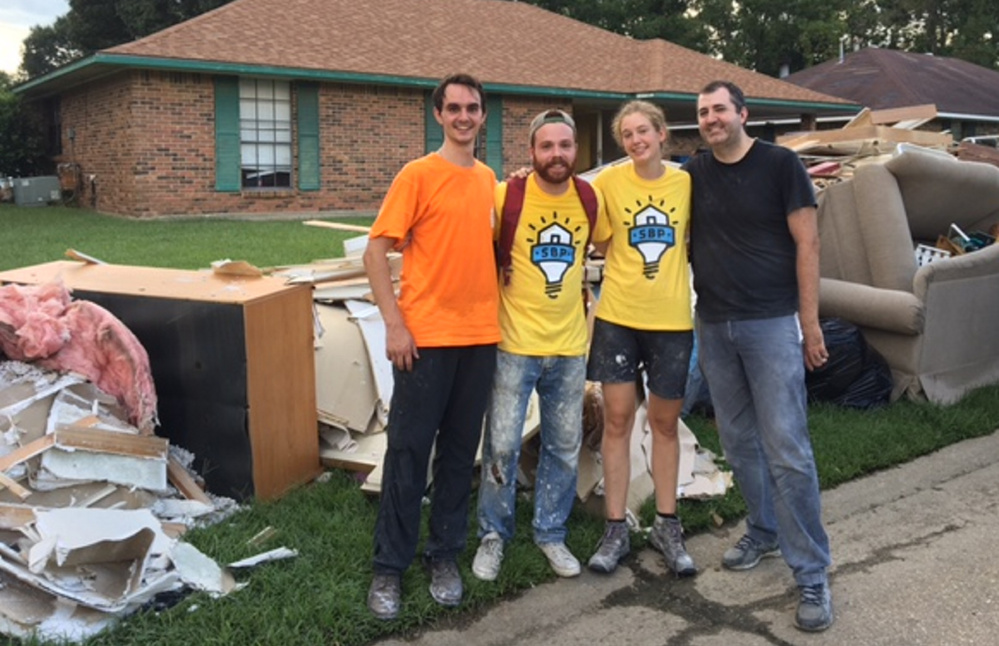 James McCullum, far left, worked recently with other volunteers in Baton Rouge, Louisiana, to help the victims of last month's historic flooding.