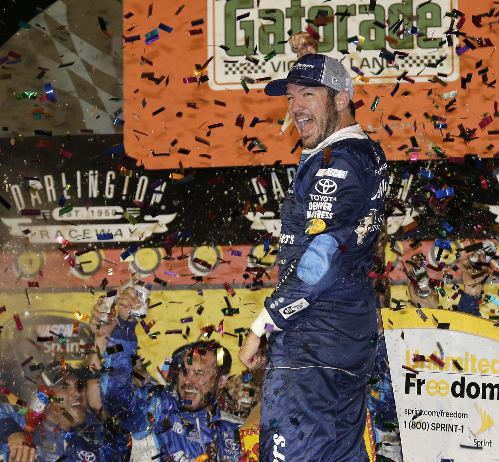 Martin Truex Jr. celebrates in Victory Lane after winning Sunday's NASCAR Sprint Cup race at Darlington Raceway in Darlington, S.C.